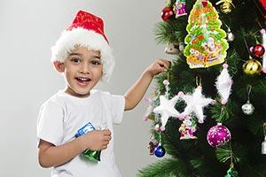 Kid Boy Festival decorating Christmas tree Smiling