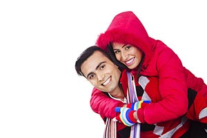 couple winter clothes playing piggyback Fun Smilin
