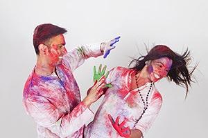 Couple colored hands Holi Celebrating Fun Applying