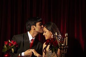Couple Dating Restaurant Kissing