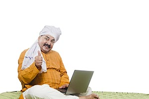 Indian Farmer Using Laptop Thumbsup