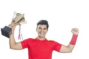 Soccer Player Celebrates Victory Trophy