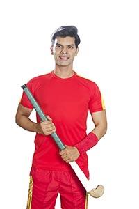 Indian Sports Hockey Player Holding Hockey Stick
