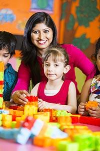 Teacher Preschoolers Playing Building Blocks Smili