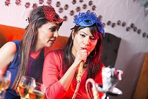 Indian Friend women Smoking Enjoying Hukka In Nigh